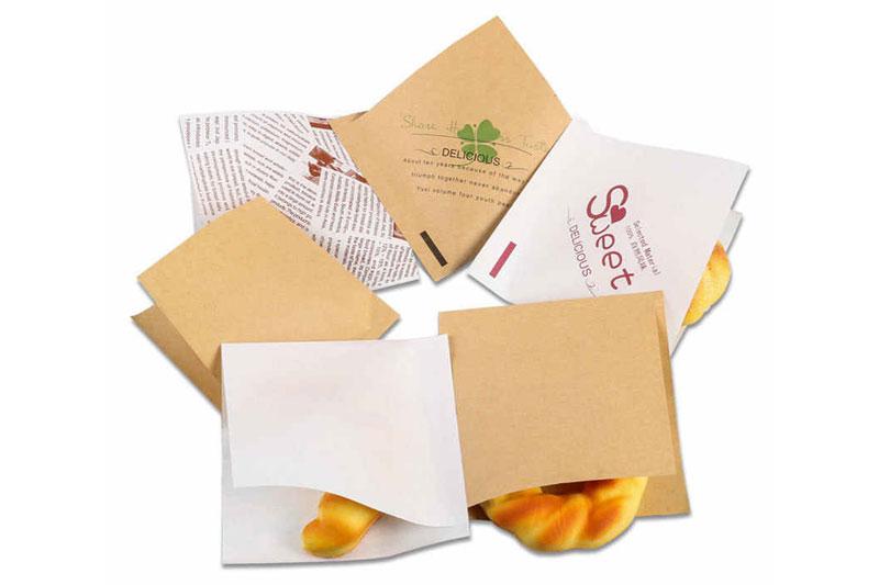 Giấy gói tráng PE gói bánh mì,... - giấy gói tráng pe